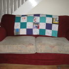 Finished quilt on the sofa - brightens up the room!